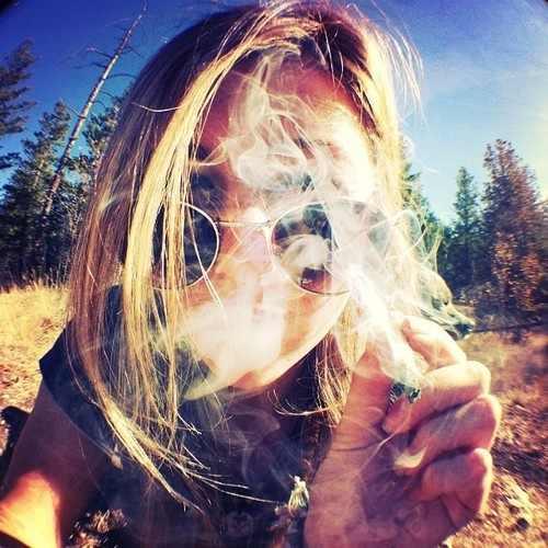 420 Babe Blowing Smoke