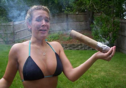 Hottie smoking a massive joint in bikini!